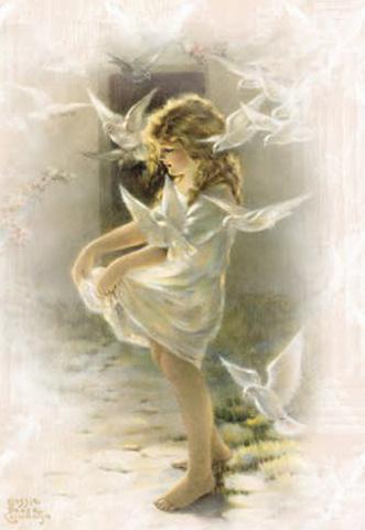 young girl feeding doves