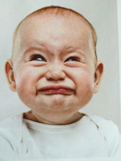 unhappy baby face