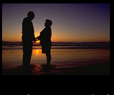 Older couple at sunset on the beach